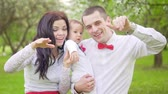 young mother : Young happy family. Daddys mom and baby are waving their hands. Slow motion
