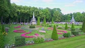 Panorama of a beautiful summer park with fountains. Peterhof