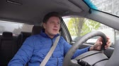 A man is driving a car and is singing. Stock Footage