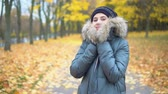 Portrait of a woman in an autumn park. Warm outerwear.
