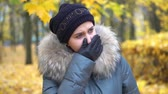 A woman is crying in an autumn park Stock Footage