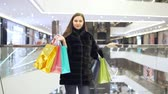 buyer : Girl with colored bags.