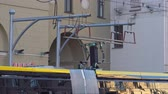 バス : Electric bus discharges the battery on the street in the city 動画素材