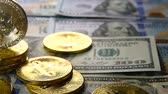 economics : Gold bitcoins and dollars. New and old money. Virtual money Stock Footage