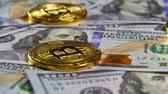 international economy : Gold coins of bitcoins and a background of hundred-dollar bills. The concept of financial operations. Economy of the future