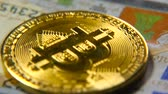 exchange : Gold bitcoins and dollars. New and old money. Virtual money Stock Footage