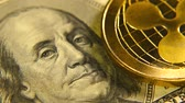 zakupy online : Gold coins ripple is a market symbol of the crypto currency. A gold metal bitcoin over a paper currency.