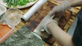 cutting fish : Preparing and cutting traditional sushi