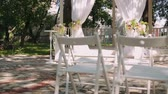 tenda : wedding decoration, wedding reception set outdoors under bright sun on resort Stock Footage