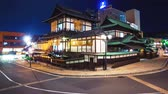 automóvel : Time lapse of the ancient Japanese bathhouse Dogo Onsen surrounded by car and foot traffic. Also available in 4k.