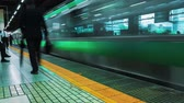 metro : Time lapse of people at hamamatsucho subway station platform on May 25, 2014 in Tokyo, Japan