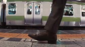 passos : Business men board subway car in slow motion. Shot with dedicated slow motion camera.