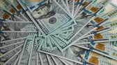 franklin : Spinning pile of 100 dollar bills Stock Footage