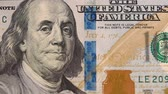 profundidade de campo rasa : Close up sliding shot of Ben Franklin on the 100 dollar bill