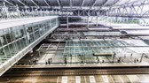 massa : Timelapse of trains and commuters inside Osaka Station in Osaka Japan. Ultra high resolution.