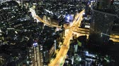infra estrutura : Multihour aerial view timelapse of a massive highway intersection at night in Shinjuku Tokyo Japan.