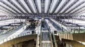 clock : Timelapse of trains and commuters inside Osaka Station in Osaka Japan. Ultra high resolution.