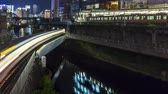 tokyo : Time-lapse of multiple train lines in Ochanomizu, Tokyo, Japan, at night.