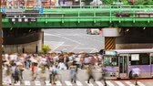 ônibus : Time-lapse of people and traffic at a busy intersection in Tokyo.