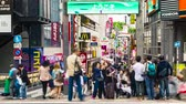 tokio : People walk and shop along the Takeshita Street in Harajuku, Tokyo, Wideo