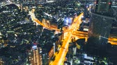 tokio : Multi-hour aerial view time-lapse of a massive highway intersection at night in Shinjuku, Tokyo, Japan