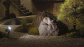 seyahat : Japanese dry-landscape rock garden in Kyoto, Japan at night. Sliding shot.