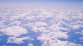 céu : Aerial view of clouds shot from aircraft in very steady slow motion.