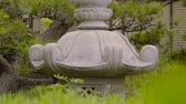 деталь : Sliding shot of of a stone lantern in a Japanese garden
