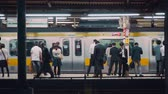 tokio : People waiting to board trains at the subway station in Tokyo, Japan Wideo