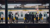 ferrovia : People waiting to board trains at the subway station in Tokyo, Japan Stock Footage