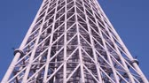 tall : TOKYO - CIRCA JUNE 2015: The Tokyo Skytree stands against the sky. Tokyo Skytree is the tallest freestanding broadcasting tower in the world. Tilting shot.