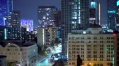escuro : View of Downtown Los Angeles buildings at night Stock Footage