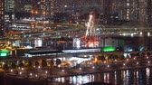 View of Odaiba, Tokyo at night with ferris wheel Stock Footage