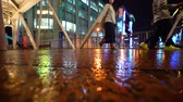 OSAKA – OCTOBER 16 2017: People walk through Osaka, Japan at night in the rain Стоковые видеозаписи