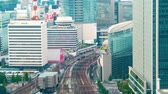 ferrovia : Time-lapse of a busy train station rail yard in Marunouchi, Tokyo, Japan Stock Footage