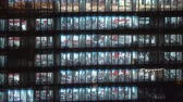 tokio : Time-lapse of am office building in Tokyo with workers working inside