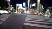 TOKYO, JAPAN - SEP, 25 2017: Traffic crosses the famous intersection in Shibuya, Tokyo, Japan one of the busiest crosswalks in the world. Wideo