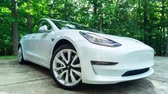 byt : RALEIGH, NC, JUNE 30, 2018: A new Tesla Model 3. The Model 3 is set to be the Teslas first mass market electric vehicle.