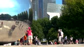 chicago : CHICAGO - SEPT. 18th 2018: Tourists visit the Cloud Gate, a public sculpture in Millennium Park
