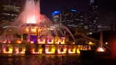editorial : Fountain against the downtown Chicago skyscrapers skyline at night Stock Footage