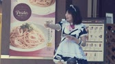 editorial : TOKYO, JAPAN - JUNE, 24 2015: Woman solicits customers to a maid cafe in Akihabara. Stock Footage