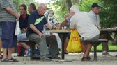 Old men playing chess outside