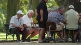 Old man chess play gathering outside