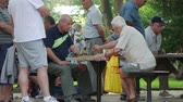 Chess players in  the city park - regural competition with senior elderly grandmasters