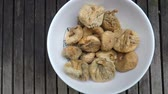 konserve : Plate with dried figs, on wood table Stok Video