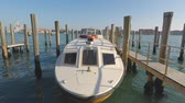 Венеция : Motor boat moored at boats wharf, Venice, Italy