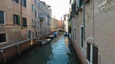 barokní : Canals view in Venice, moored boats around