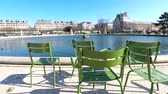 Few chairs at pond on a sunny day in Paris, France