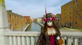 Carnival of Venice, Italy – February 2018. Costumed actor at bridge. Actor with great mask pose, no tourists. Carnevale di Venezia