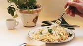 hard cheese : Spaghetti - the stuffed and spiced pasta is rolled up with a fork and eaten.